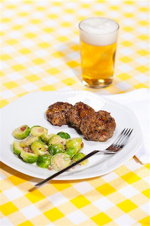 Plate of dumplings and brussels sprouts Stock Photo - Premium Royalty-Free, Code: 649-06400753