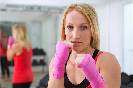 Boxer holding fists up in gym Stock Photo - Premium Royalty-Free, Code: 649-06400794