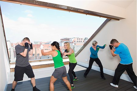 fitness older women gym - Trainers working with boxers in gym Stock Photo - Premium Royalty-Free, Code: 649-06400825