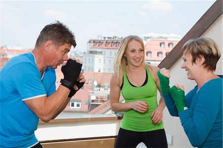 fitness older women gym - Trainers working with boxers in gym Stock Photo - Premium Royalty-Free, Code: 649-06400826