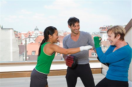 Trainers working with boxers in gym Stock Photo - Premium Royalty-Free, Code: 649-06400827