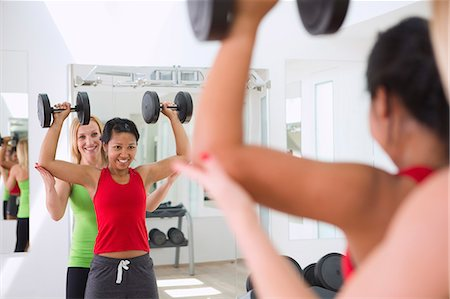 form - Woman working with trainer in gym Stock Photo - Premium Royalty-Free, Code: 649-06400832