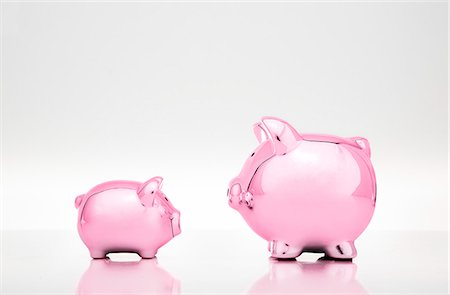 Large and small piggy banks Stock Photo - Premium Royalty-Free, Code: 649-06400871