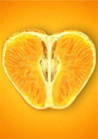 Close up of halved orange Stock Photo - Premium Royalty-Free, Code: 649-06400892