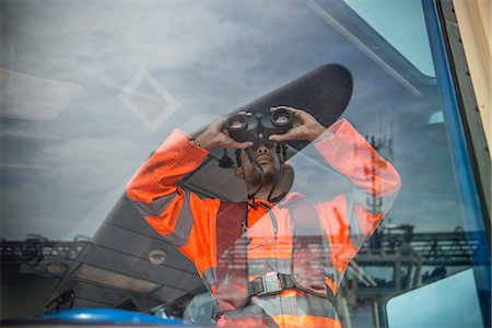 safety - Worker on tug boat using binoculars Stock Photo - Premium Royalty-Free, Code: 649-06400902