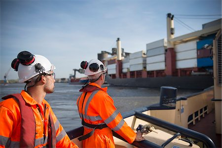ships at sea - Workers on tug boat overlooking ship Stock Photo - Premium Royalty-Free, Code: 649-06400928