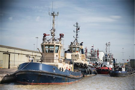 property release - Tug boats docked in urban harbor Stock Photo - Premium Royalty-Free, Code: 649-06400921