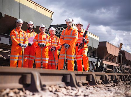 Railway workers standing on train tracks Stock Photo - Premium Royalty-Free, Code: 649-06400955