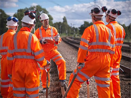 safety - Railway workers talking on train tracks Stock Photo - Premium Royalty-Free, Code: 649-06400958