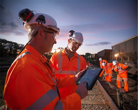 equipment - Railway workers using tablet computer Stock Photo - Premium Royalty-Free, Code: 649-06400974