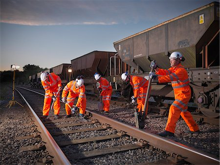 equipment - Railway workers adjusting train tracks Stock Photo - Premium Royalty-Free, Code: 649-06400971