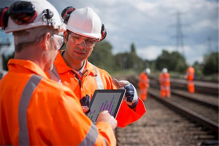 safety - Railway workers using tablet computer Stock Photo - Premium Royalty-Free, Code: 649-06400986