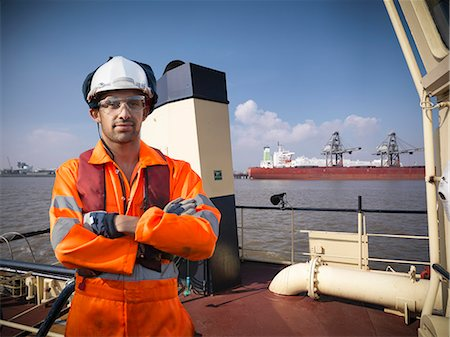 Tugboat worker standing on deck Stock Photo - Premium Royalty-Free, Code: 649-06401015