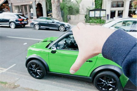 Man pretending to hold car Stock Photo - Premium Royalty-Free, Code: 649-06401136