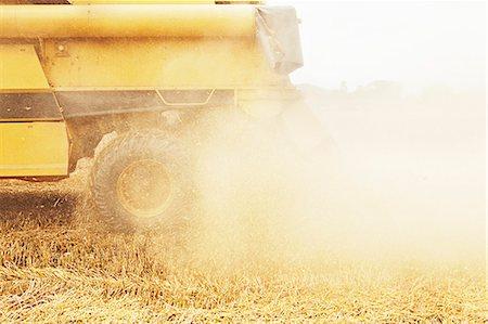 Tractor harvesting grains in crop field Stock Photo - Premium Royalty-Free, Code: 649-06401206