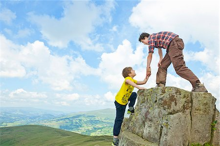 Boys climbing rural rock formation Stock Photo - Premium Royalty-Free, Code: 649-06401305