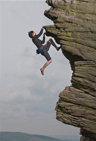 rock climber - Rock climber scaling rock formation Stock Photo - Premium Royalty-Free, Code: 649-06401315