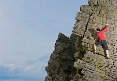 Rock climber scaling rock formation Stock Photo - Premium Royalty-Free, Code: 649-06401317