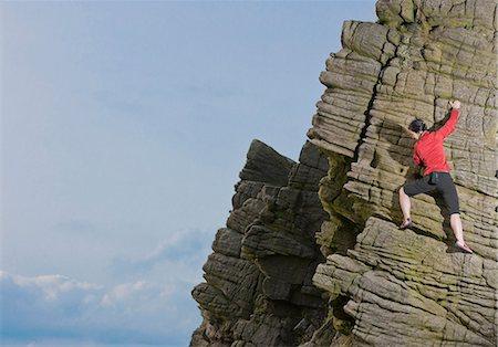 rock climber - Rock climber scaling rock formation Stock Photo - Premium Royalty-Free, Code: 649-06401317