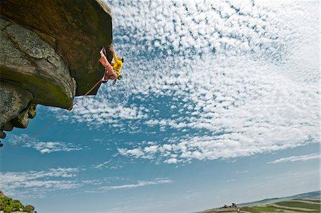 rock climber - Rock climber scaling rock formation Stock Photo - Premium Royalty-Free, Code: 649-06401324
