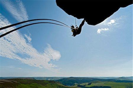 rock climber - Rock climber scaling rock formation Stock Photo - Premium Royalty-Free, Code: 649-06401325
