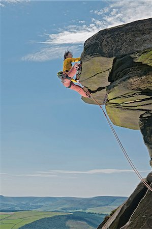 rock climber - Rock climber scaling rock formation Stock Photo - Premium Royalty-Free, Code: 649-06401322