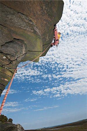 rock climber - Rock climber scaling rock formation Stock Photo - Premium Royalty-Free, Code: 649-06401323