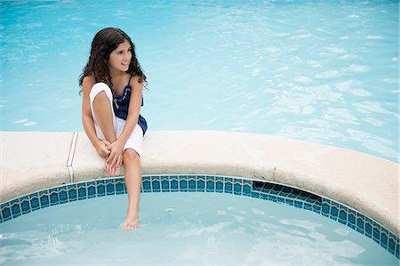 preteen swim - Girl dangling foot in swimming pool Stock Photo - Premium Royalty-Free, Code: 649-06401402
