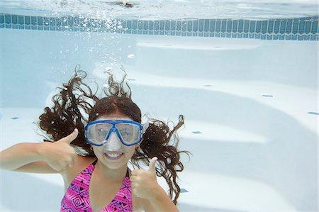 preteen swim - Girl giving thumbs up underwater Stock Photo - Premium Royalty-Free, Code: 649-06401425