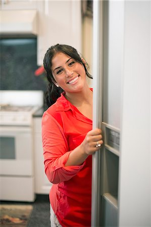 fridge - Smiling woman opening fridge door Stock Photo - Premium Royalty-Free, Code: 649-06401420