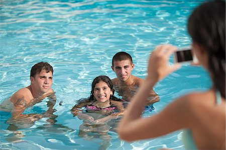 recreation - Woman taking pictures of family in pool Stock Photo - Premium Royalty-Free, Code: 649-06401445