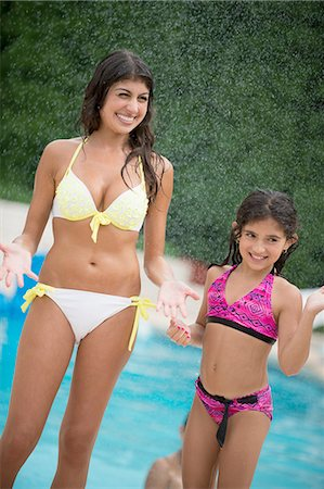 Sisters standing by swimming pool Stock Photo - Premium Royalty-Free, Code: 649-06401447