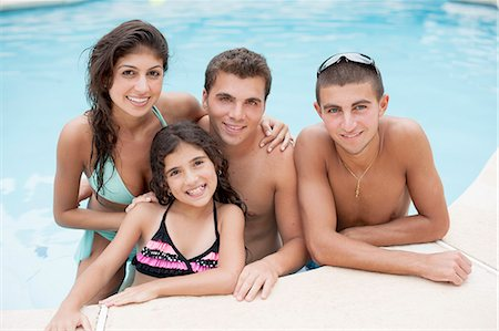 Family relaxing in swimming pool Stock Photo - Premium Royalty-Free, Code: 649-06401441