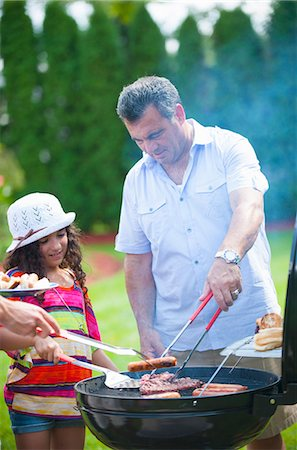 Father and daughter grilling outdoors Stock Photo - Premium Royalty-Free, Code: 649-06401459