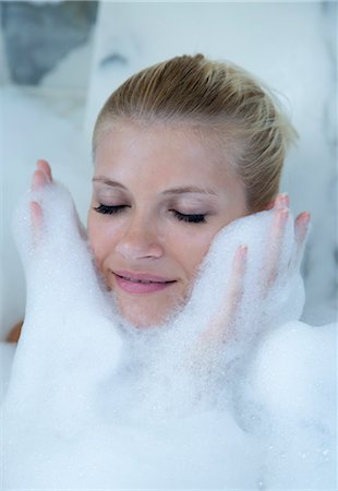 Woman playing in bubble bath Stock Photo - Premium Royalty-Free, Code: 649-06432265
