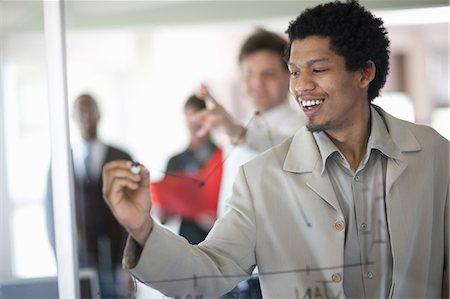 Businessman drawing graph on window Stock Photo - Premium Royalty-Free, Code: 649-06432325