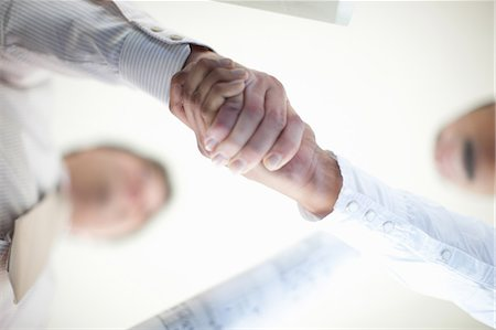 Close up of businessmen shaking hands Stock Photo - Premium Royalty-Free, Code: 649-06432328
