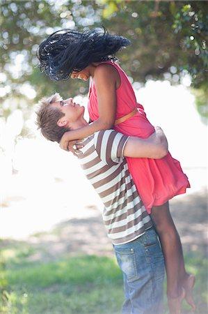 romanticism - Man lifting girlfriend outdoors Stock Photo - Premium Royalty-Free, Code: 649-06432338