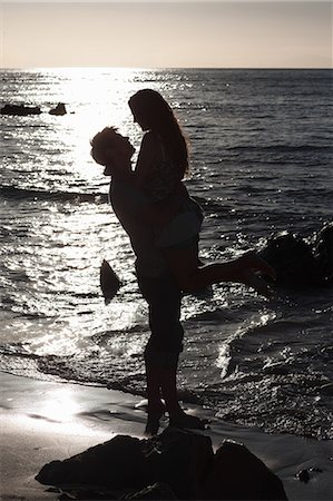 silhouettes - Man lifting girlfriend on beach Stock Photo - Premium Royalty-Free, Code: 649-06432363