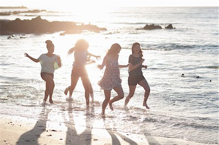 Women running together on beach Stock Photo - Premium Royalty-Free, Code: 649-06432375