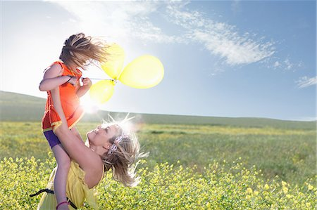 Sisters playing in field of flowers Stock Photo - Premium Royalty-Free, Code: 649-06432414