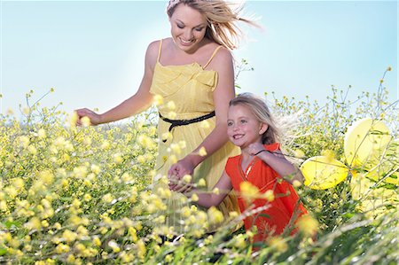 Sisters playing in field of flowers Stock Photo - Premium Royalty-Free, Code: 649-06432413