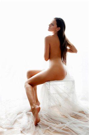 Nude woman sitting on stool Stock Photo - Premium Royalty-Free, Code: 649-06432458