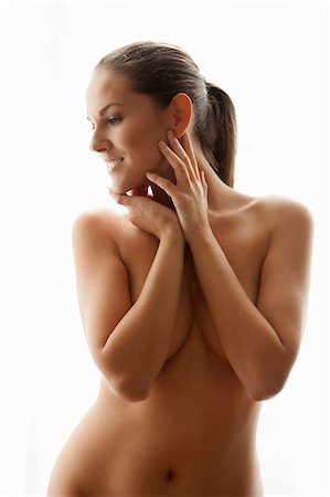 Nude woman covering her breasts Stock Photo - Premium Royalty-Free, Code: 649-06432460