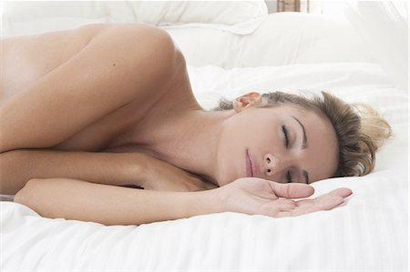 sleeping nude - Nude woman sleeping on bed Stock Photo - Premium Royalty-Free, Code: 649-06432476