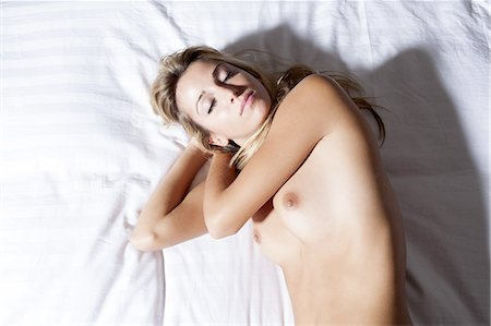 female nude breast sexy - Nude woman sleeping on bed Stock Photo - Premium Royalty-Free, Code: 649-06432482