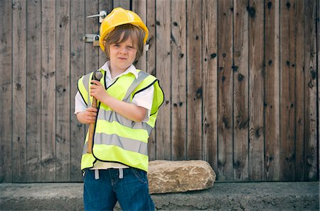 security - Boy playing construction worker Stock Photo - Premium Royalty-Free, Code: 649-06432495