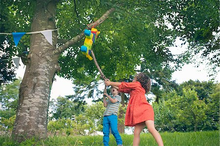 stick - Children swinging at pinata at party Stock Photo - Premium Royalty-Free, Code: 649-06432520
