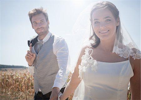 Newlywed couple walking outdoors Stock Photo - Premium Royalty-Free, Code: 649-06432538