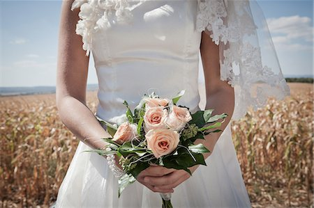 Newlywed bride holding bouquet Stock Photo - Premium Royalty-Free, Code: 649-06432544